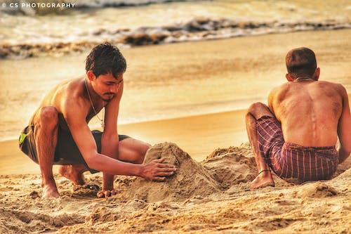 Foto profissional grátis de areia, areia da praia, construir, esculturas de areia