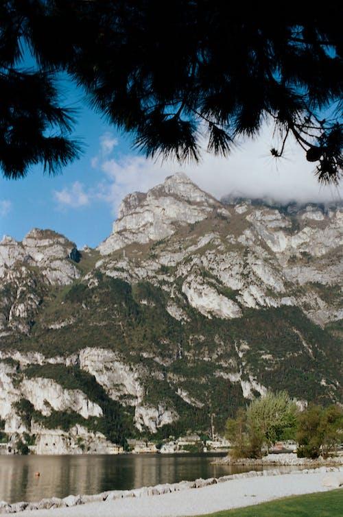 Massive mountain near calm sea in highlands