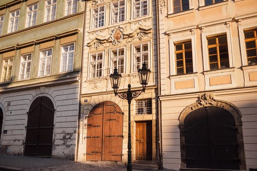 Old stone building facades with ornament in town
