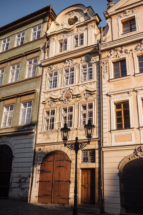 Aged house facade with decor in city