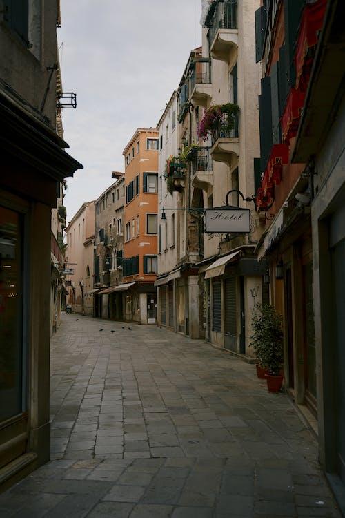 Narrow pedestrian street between old residential buildings