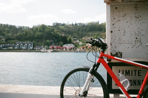 Bicycle parked on embankment near river