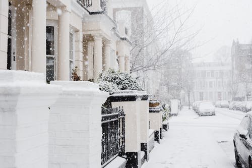 Snowy street with residential buildings