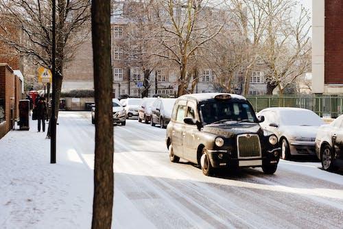 Retro car driving on snowy road