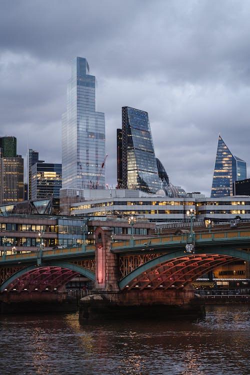 Contemporary financial buildings near suspension bridge