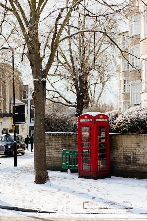 Telephone booth on snowy street