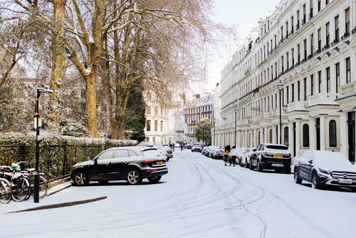 London streets covered with snow on sunny day