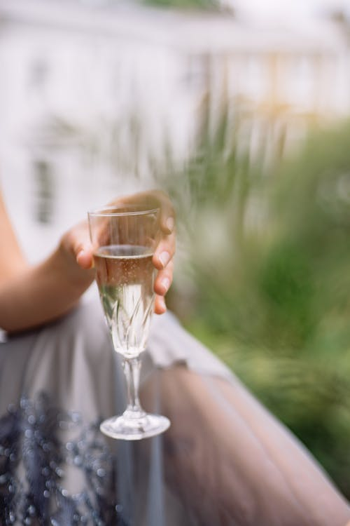 A Person Holding a Glass of White Wine