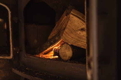 Wood burning in fireplace in dark room