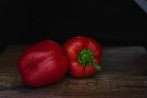 Tasty fresh red sweet bell peppers on table