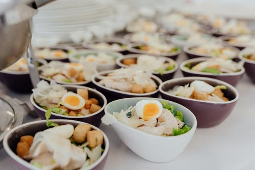 Bowls with salad on buffet table