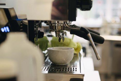 White Ceramic Cup on Silver Espresso Machine