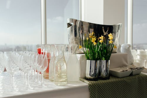 Buffet table with glassware and flowers