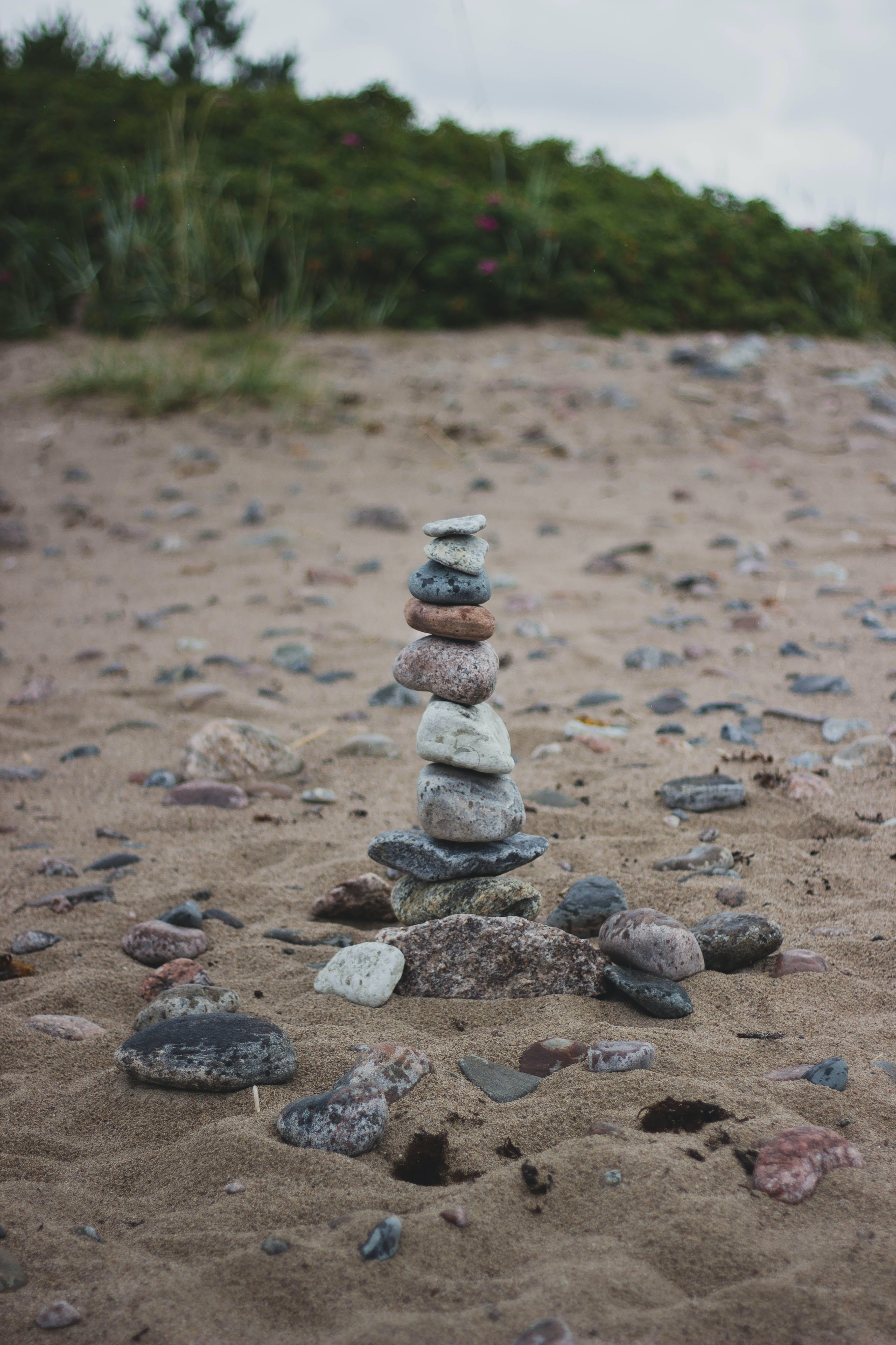 Stack of Stones on the Middle of Brown Soil