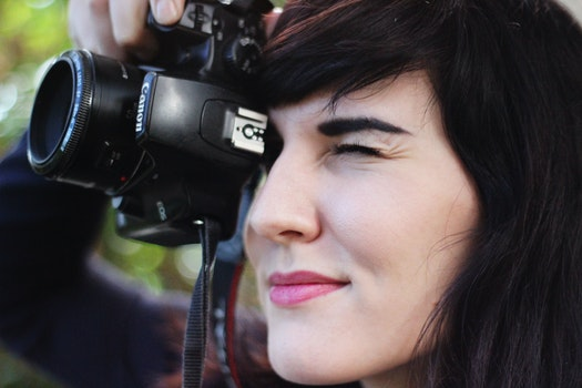 Woman Taking a Photo With Canon Dslr Camera