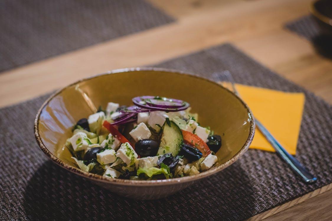 Vegetable Slices on Brown Ceramic Bowl