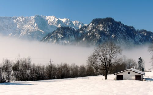 Free stock photo of Foggy landscape, mountain rocks, snow