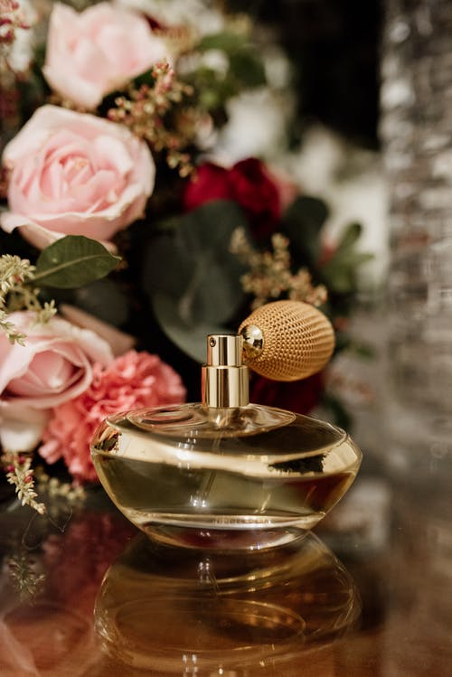 Gold and Gold Perfume Bottle