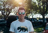 Man Wearing White and Black Bear Printed Shirt and Sunglasses