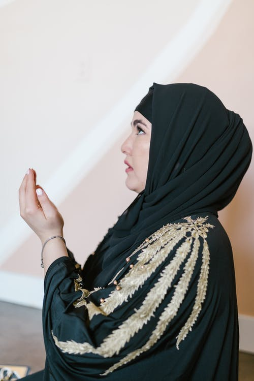 Woman in Black Hijab and White and Black Floral Dress