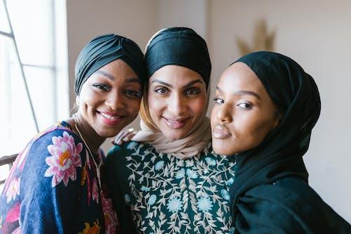 2 Women Smiling Wearing Hijab