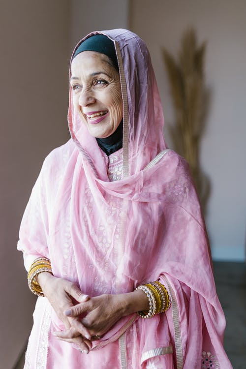 Woman in Pink Hijab and Gold Bracelet