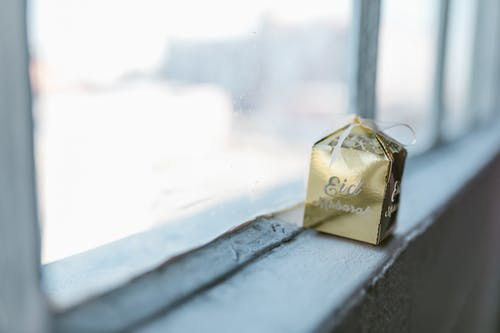 Golden Gift Box By The Window