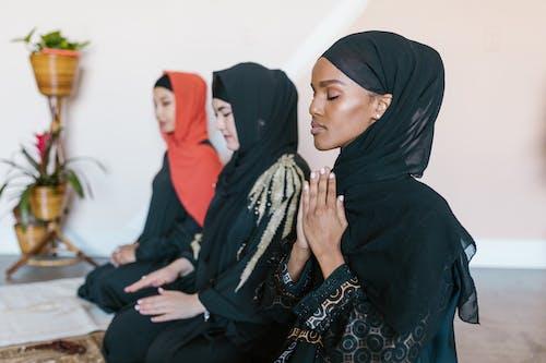 Women in Black Hijab Praying