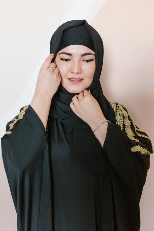 Woman in Black Hijab and Brown and Black Floral Long Sleeve Shirt