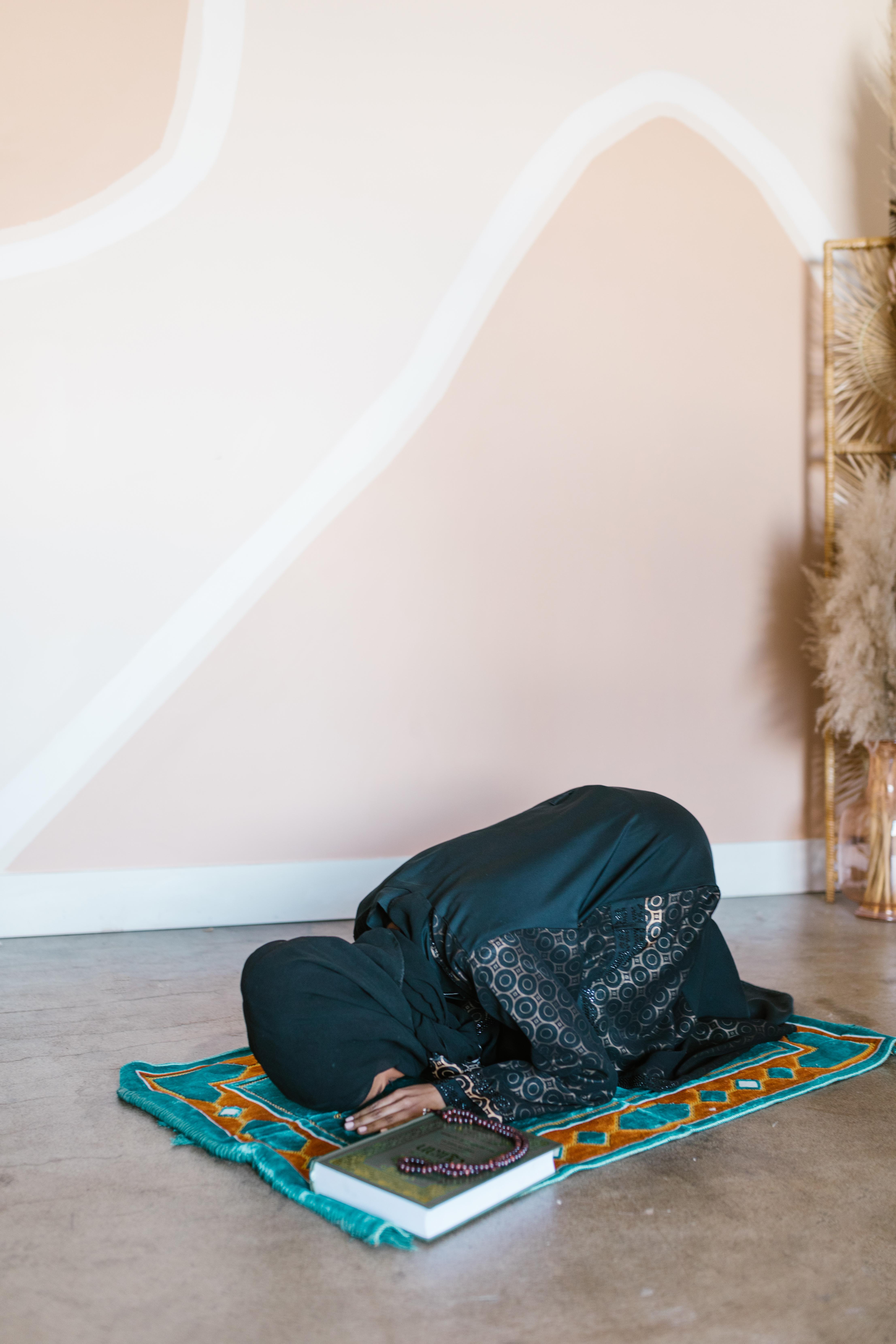 person in black pants sitting on floor