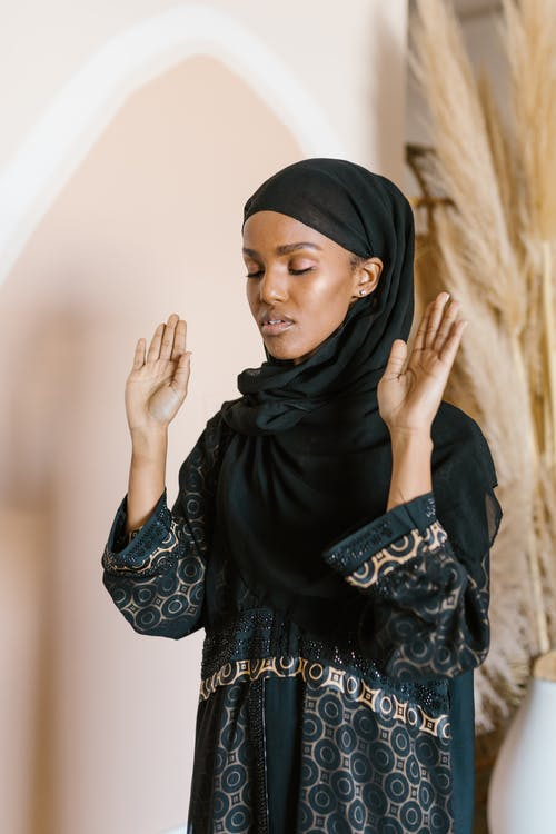 Woman in Black Hijab Covering Her Face