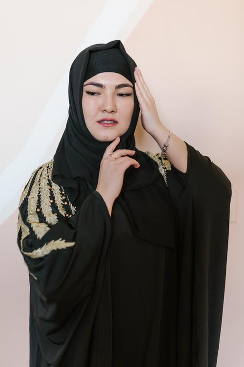 Woman in Black Hijab and Black and White Floral Hijab