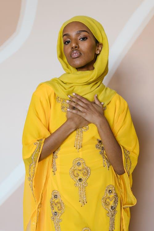 Woman in Yellow Hijab and Yellow Dress