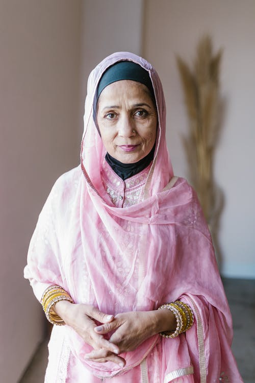 Woman in Pink Hijab and White Long Sleeve Shirt