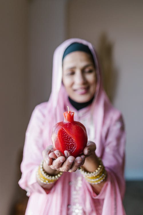 Woman in Pink Hijab Holding Strawberry
