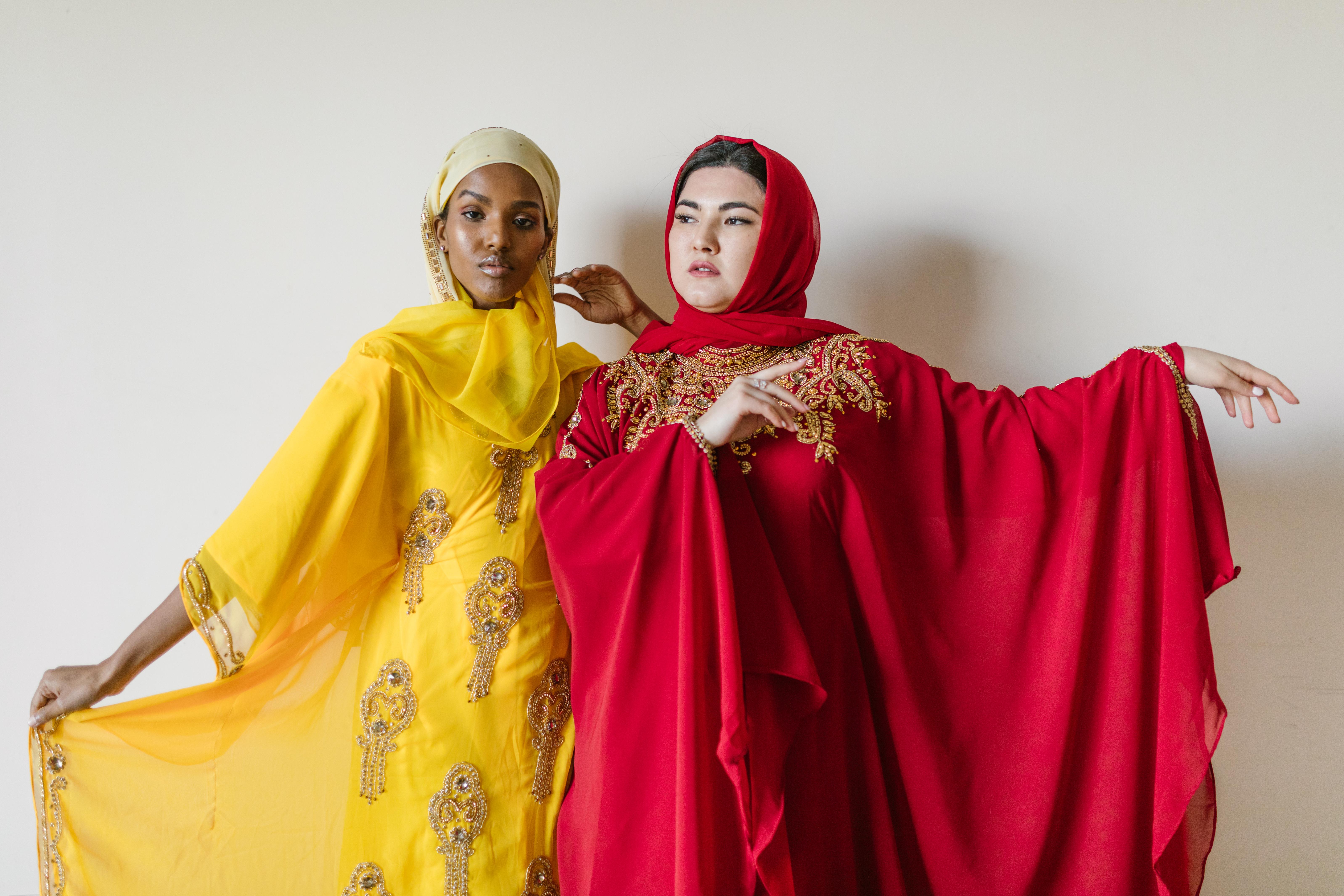 woman in yellow hijab and red abaya