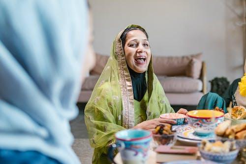 Smiling Woman in Green Hijab