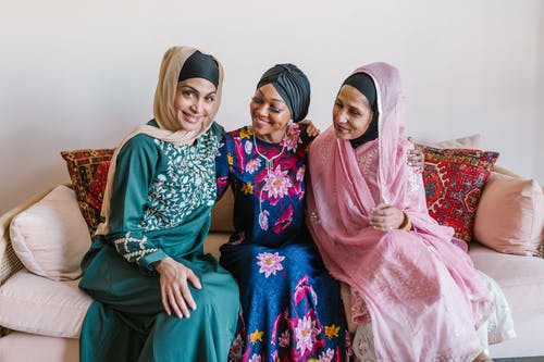2 Women in Hijab Sitting on Couch