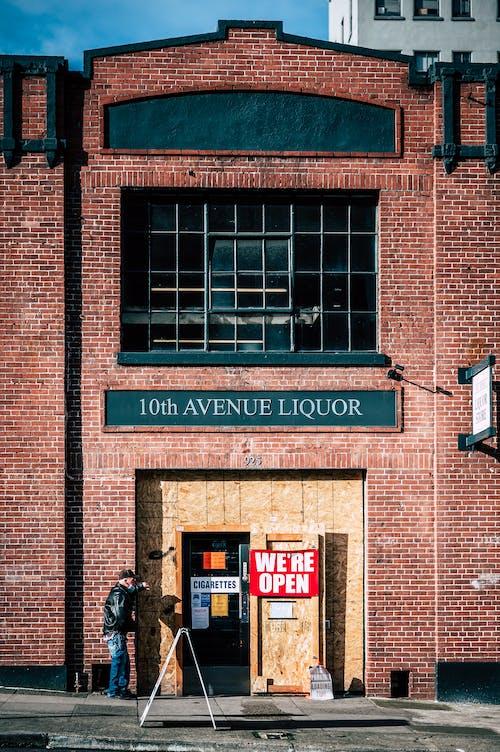 Black Motorcycle Parked Beside Brown Brick Building