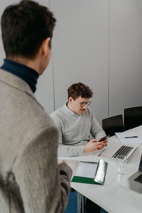 Men Working Inside an Office
