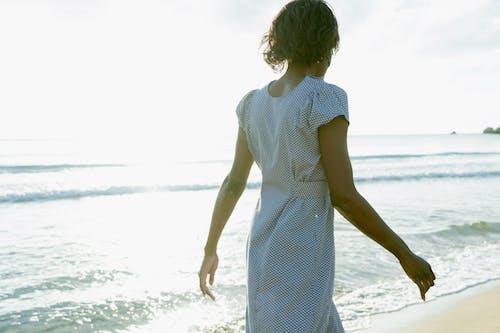 A Woman Walking in the Beach