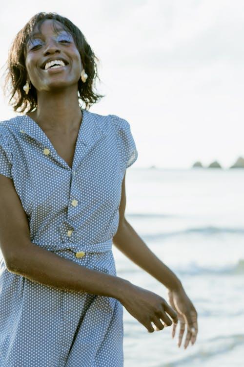 A Woman Wearing a Polka Dots Dress in the Beach