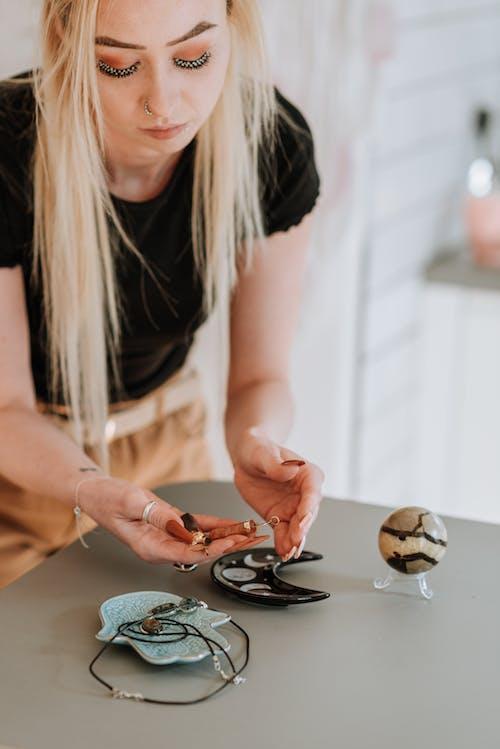 Enchantress with long hair preparing magic items for prediction