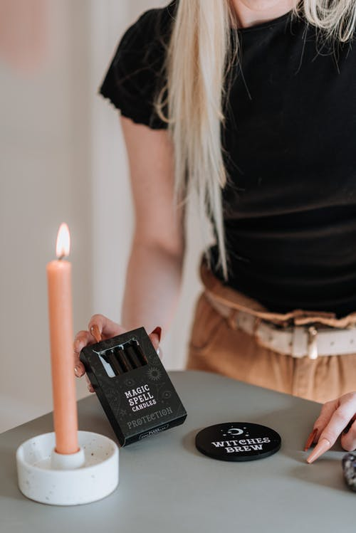 Woman preparing for ritual with witch items