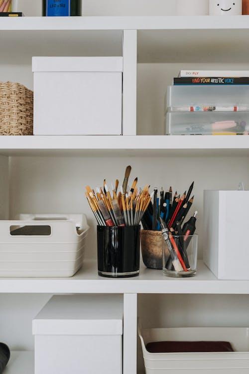 Shelves with various art equipment
