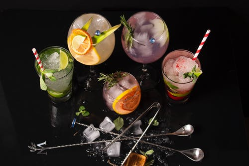 Assorted Cocktail Drinks on Black Surface