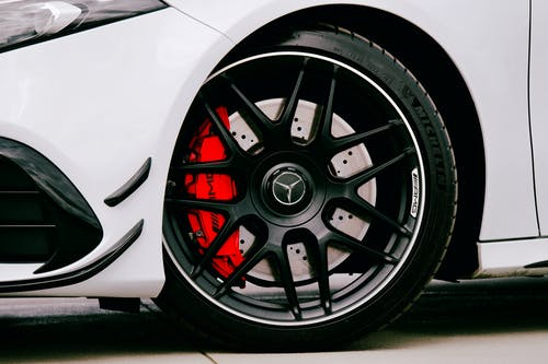 White Car With Black and Silver Wheel