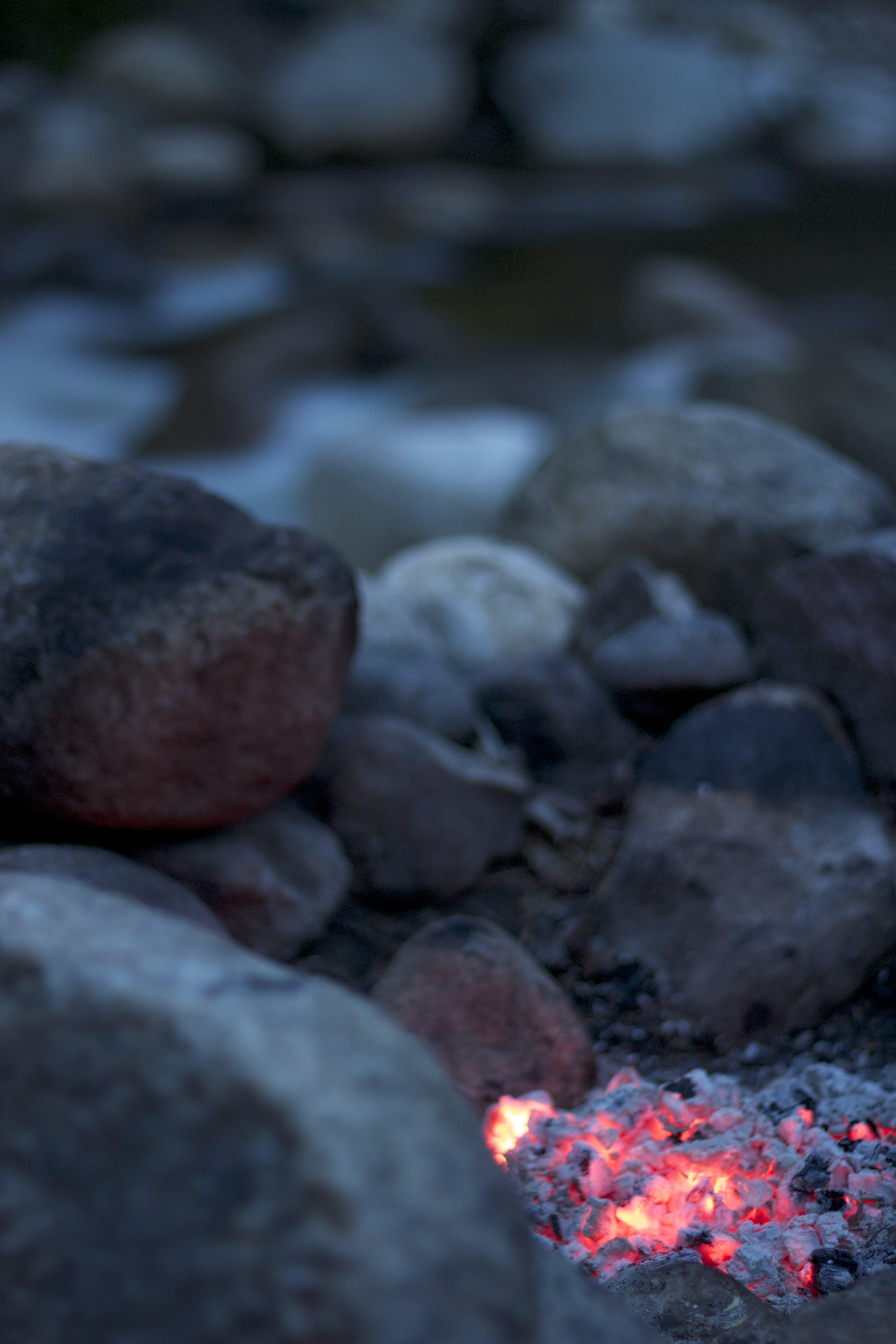 Burning Firelog Surrounded of Pebbles