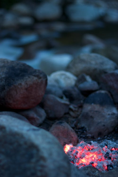 Burning Firelog Surrounded of Pebbles