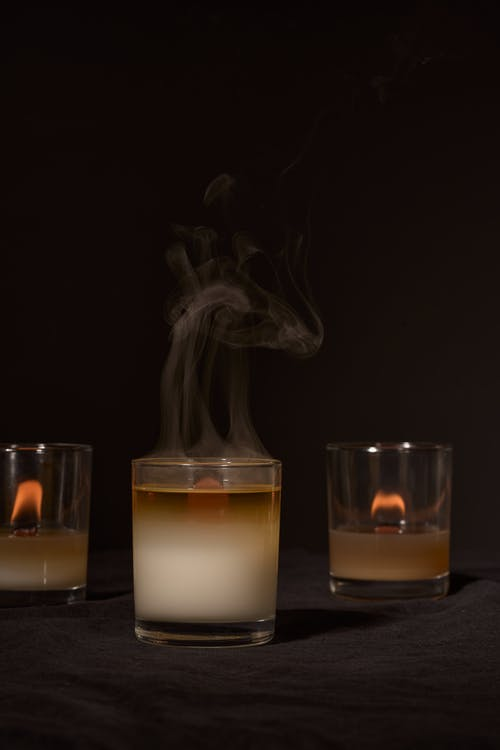 Burning candles with smoke for aromatherapy